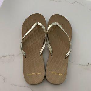 Metallic gold Tory Burch flip flops